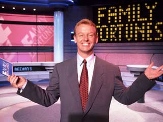 File:Family fortunes shrug.jpg